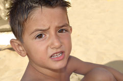 Angry child. Stroppy child at the beach says something Royalty Free Stock Photography