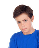 Angry child with ten years old and blue t-shirt. Isolated on a white background royalty free stock image