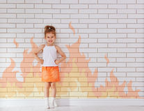 Angry child. On the wall background royalty free stock photography