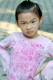 Angry chinese child. The little girl may be angry Stock Photo