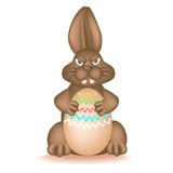 Angry chocolate Bunny. Grabbed easter egg Stock Photography