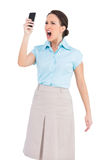 Angry Classy Businesswoman Shouting At Her Smartphone Royalty Free Stock Image