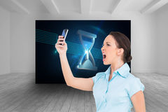 Angry classy businesswoman yelling at her smartphone Stock Photo