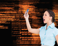 Angry classy businesswoman yelling at her smartphone Royalty Free Stock Image