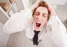Angry clerk in wide angle shouting Royalty Free Stock Photos