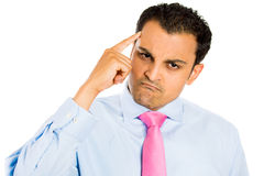Angry. Closeup portrait of Upset, angry handsome man with finger on his head, isolated on white background stock photos