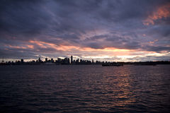 Angry clouds over downtown Vancouver. Angry, dark clouds cover the sunset of Vancouver Royalty Free Stock Photos