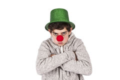Angry clown. Closeup portrait of young teenage girl with clown costume Stock Image