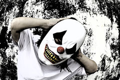 Angry clown. Crazy clown mask halloween costume and fear stock photos