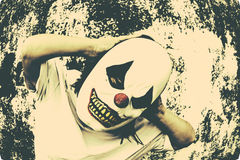 Angry clown. Crazy clown mask halloween costume and fear stock photography