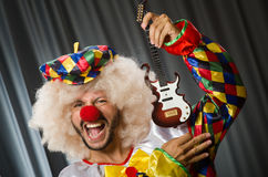 Angry clown with guitar Royalty Free Stock Image