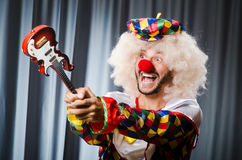 Angry clown with guitar Stock Photos