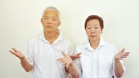 Angry complain Asian elderly couple with upset expression and ge Royalty Free Stock Photo
