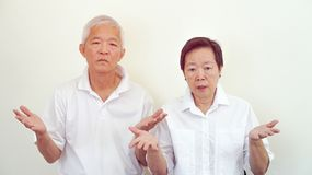 Angry complain Asian elderly couple with upset expression and ge Royalty Free Stock Images