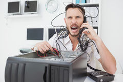 Angry computer engineer making a call Royalty Free Stock Images