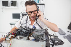 Angry computer engineer making a call Stock Photo