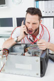 Angry computer engineer making a call Royalty Free Stock Photography