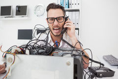 Angry computer engineer making a call Royalty Free Stock Photo