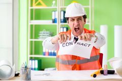 The angry construction supervisor cancelling contract. Angry construction supervisor cancelling contract stock photo