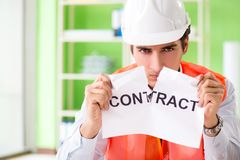 The angry construction supervisor cancelling contract stock image