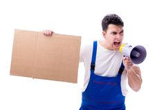 The angry construction supervisor yelling with loudspeaker royalty free stock photography