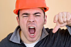 Angry Construction Worker. This construction worker is pointing and yelling his head off at someone stock photos