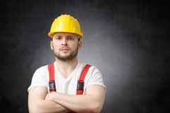 Angry construction worker. Annoyed construction worker with his arms crossed Royalty Free Stock Photo