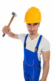Angry construction worker with a hammer Royalty Free Stock Photos