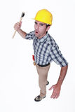 Angry construction worker. Holding a hammer royalty free stock photo