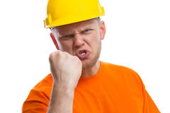 Angry construction worker. Isoalted white Royalty Free Stock Image