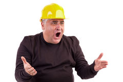 Angry construction worker looking at something. Isolated on white background Stock Photo