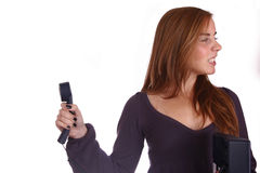 Angry with the conversation. Woman with a phone, bored/angry with the conversation Stock Images