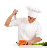 Angry cook with knife and carrots Stock Photo