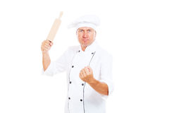 Angry cook with rolling pin Stock Images