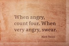 Very angry Twain. When angry, count four. When very angry, swear - famous American writer Mark Twain quote printed on vintage grunge paper Royalty Free Stock Photo