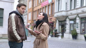 Angry couple arguing in a city. And not reaching an agreement (Full HD stock video