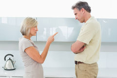 Angry couple arguing in kitchen Royalty Free Stock Photo