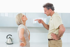 Angry couple arguing in kitchen Royalty Free Stock Images