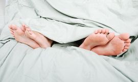 Angry couple in bed Royalty Free Stock Photography