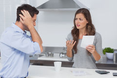 Angry couple doing their accounts Royalty Free Stock Image