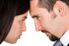 Angry couple facing each other Stock Images