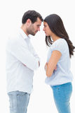Angry couple facing off after argument Stock Image