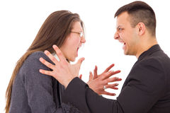 Angry couple fighting wanting to strange each other Royalty Free Stock Photos