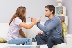 Angry couple having an argument in their living room royalty free stock image