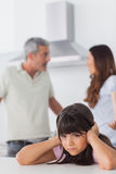Angry couple having dispute in front of their daughter blocking Royalty Free Stock Image