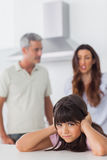 Angry couple having dispute in front of their daughter Stock Photo