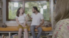 Angry couple having a marital crisis fighting and blaming each other analyzed by female counselor during couple therapy session -. Angry couple having a marital stock footage