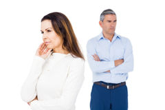 Angry couple ignoring each other. Against white background Stock Photography
