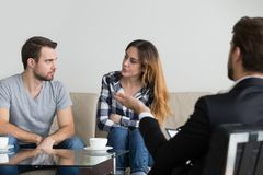 Angry couple looking at each other taking therapy session royalty free stock photo