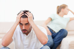 Angry couple mad at each other. In their living room Royalty Free Stock Photography